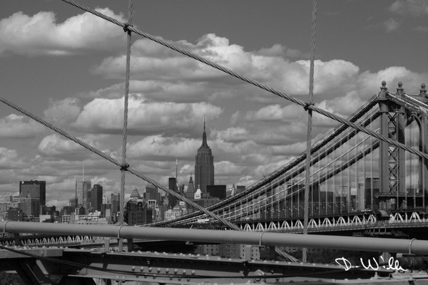 The Empire State Building seen from the Brooklyn Bridge in Manhattan, New York City, NY, United States of America