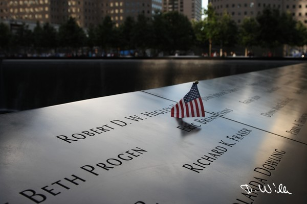 A small flag at the 9/11 Memorial in Manhattan, New York City, NY, United States of America