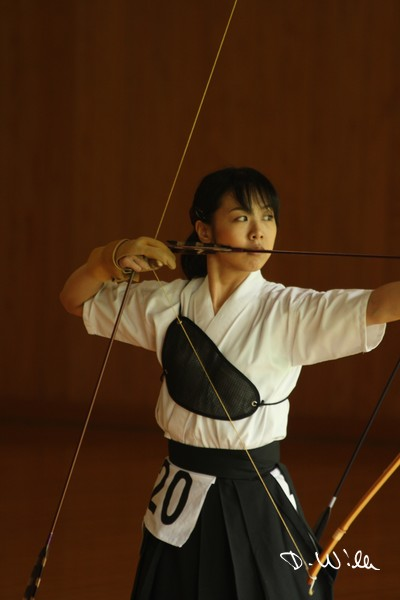 Traditional Japanese longbow archery at the martial arts center near the Meiji shrine in Harajuku, Tokyo, Japan