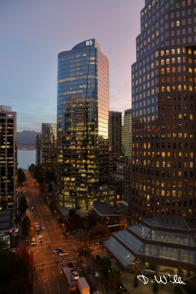 Reflection of the sunrise on Five Bentall Centre, Vancouver, BC, Canada