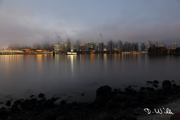 The skyline of Vanouver City covered in fog, Vancouver, BC, Canada