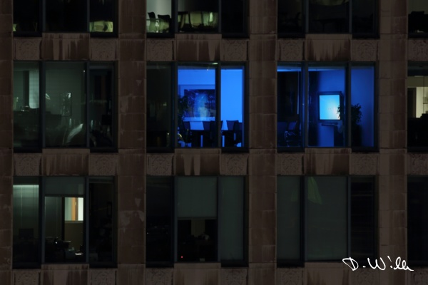 Office illuminated by a login screen on a big TV, Vancouver, BC, Canada