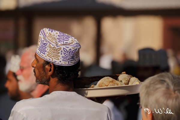 Man carrying fresh honeycomb, Nizwa, Oman