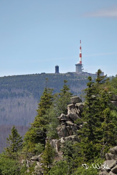 Rock formation with the Brocken in the background, Harz, Germany