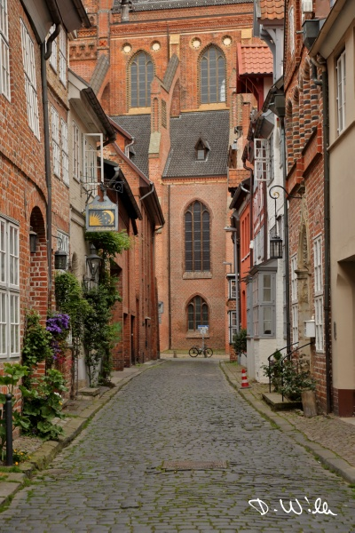 Small alley leading towards Saint Nicolai church, Lüneburg, Germany