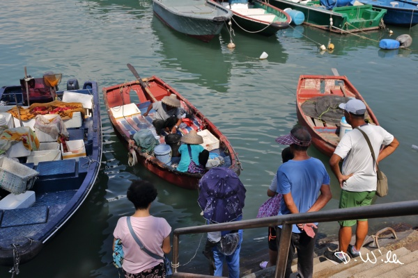 Fishers selling fish directly from their boat, Cheung Chau, Hong Kong
