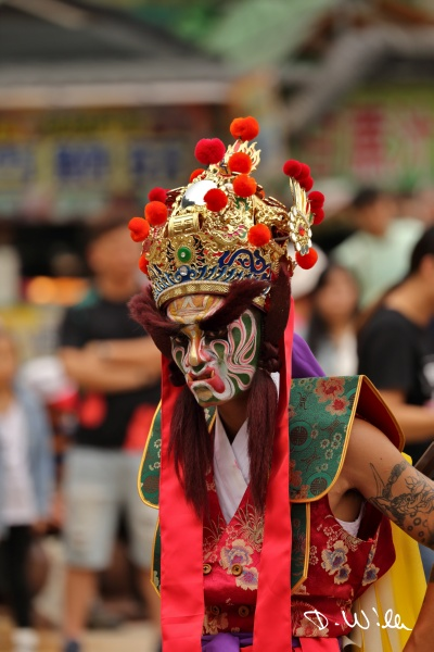 Man dressed up for a religious festival at Longyin Temple, Chukou, Taiwan
