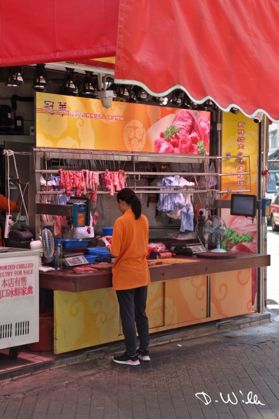Woman selling meat, Aberdeen, Hong Kong