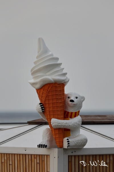 Ice bear figure holding a soft ice on top of a beach bar, Binz, Rügen, Germany