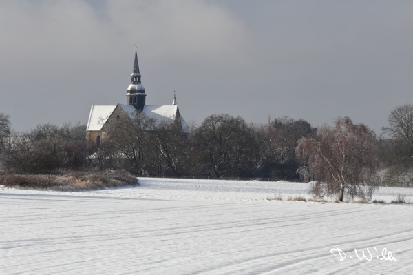 Snow covered fields with Riddagshausen Abbey in the background, Riddagshausen, Braunschweig, Germany
